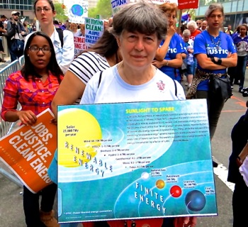 photos of climate change marchers signs